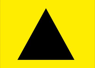 Ein schwarzes Dreieck von einem gelben Hintergrund.